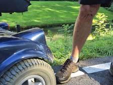 Bestuurder scootmobiel uit water gered door omstanders