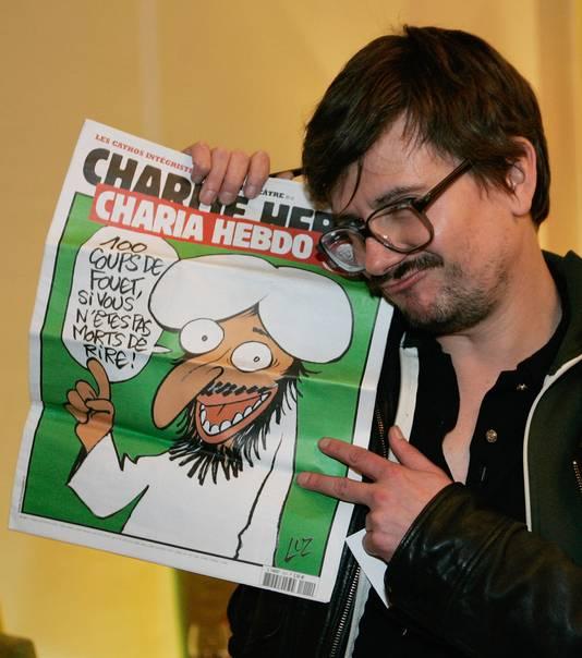 De cartoonist met de vorige cover.