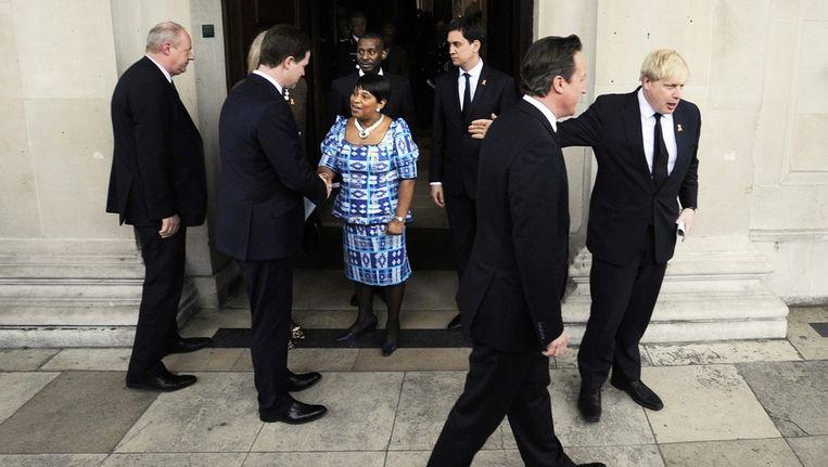 Burgemeester van Londen Johnson (rechts) en premier Cameron bij de herdenkingsdienst voor Stephen Lawrence, vorige week. Beeld epa