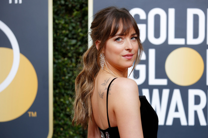 Dakota Johnson tijdens de Golden Globes.