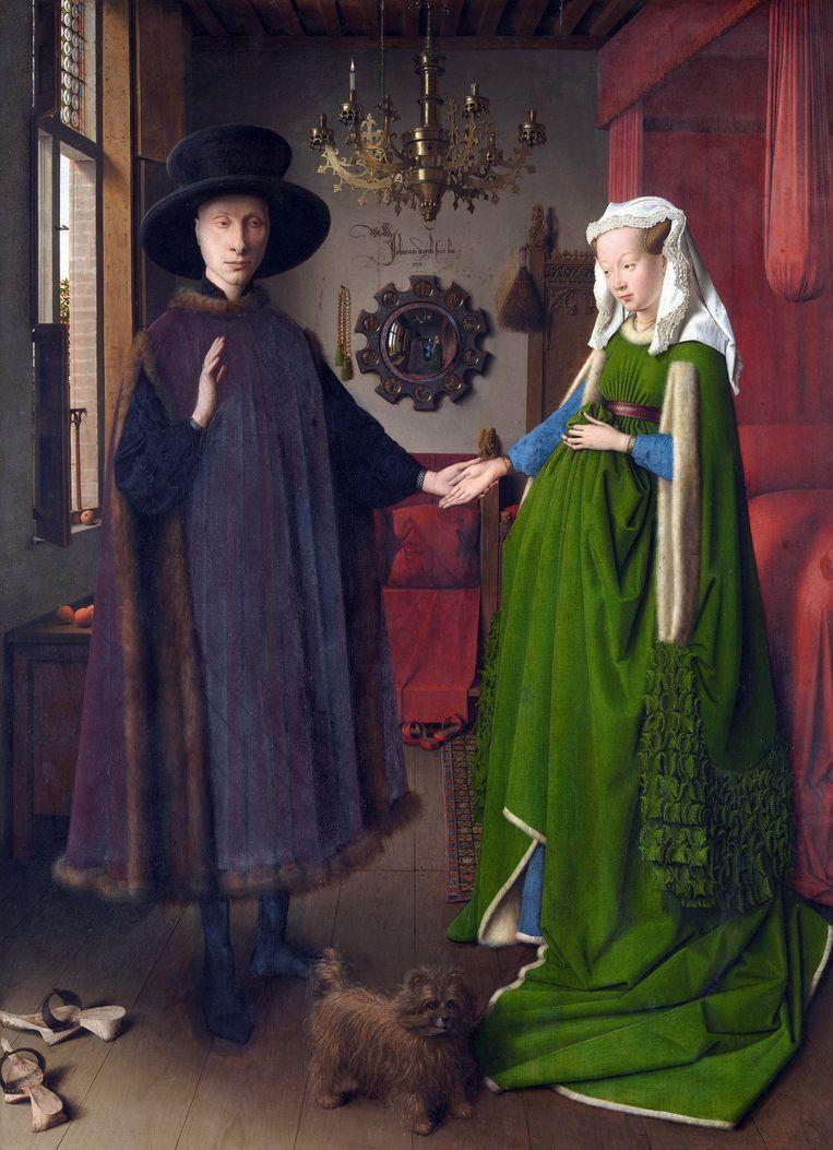 Portret van Giovanni Arnolfini en zijn vrouw, geschilderd door Jan van Eyck in 1434. Links op de voorgrond een paar houten trippen voor buiten. Tussen de echtelieden in, op de grond vóór de rode sprei, staan twee rode leren liefdestrippen. Beeld Getty