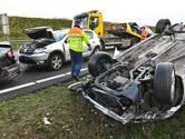 Auto over de kop gevlogen op A58 bij Ulvenhout, weg weer vrij