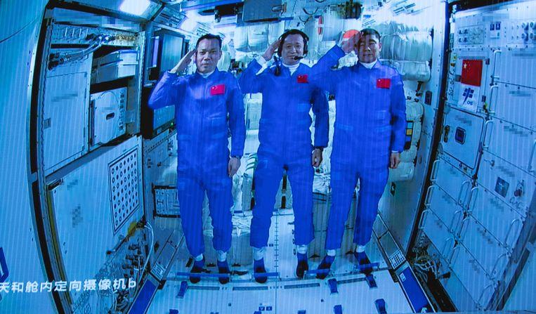 De drie Chinese astronauten.  Beeld EPA