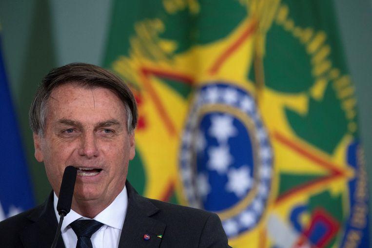 De Braziliaanse president Jair Bolsonaro is boos op milieuorganisaties die hem verwijten 'het regenwoud in brand te steken'. Beeld EPA