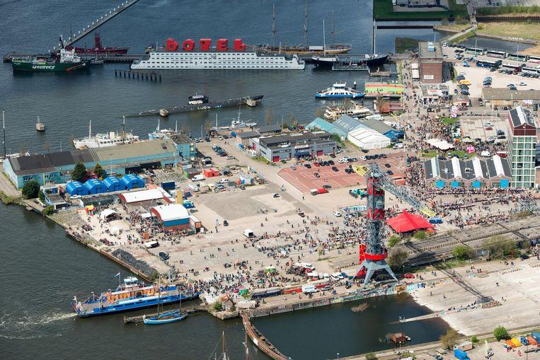 De NDSM-werf tijdens festival Digital. Foto is genomen vanaf de oostkant, waar het groen komt.  Beeld ANP
