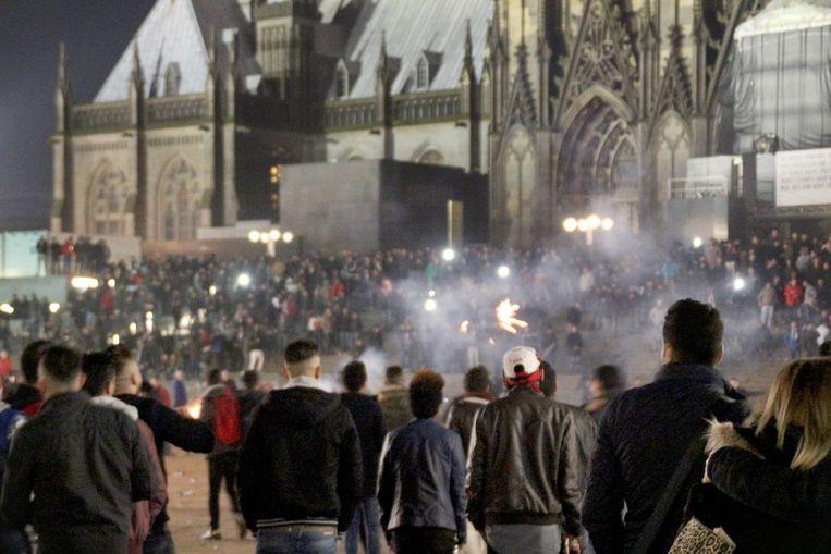 Beelden van de massa volk op oudejaarsavond in Keulen. Beeld EPA