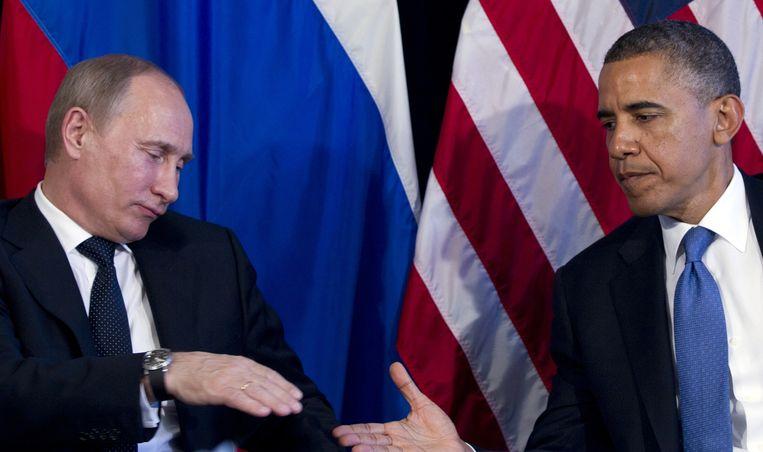 Poetin en Obama tijdens een ontmoeting op de G20-top in juni 2012 in Los Cabos, Mexico. Beeld ap