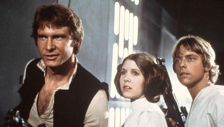 Han Solo (Harrison Ford), prinses Leia (Carrie Fisher) en Luke Skywalker (Mark Hamill) strijden tegen de dark side in de originele trilogie. Beeld AP