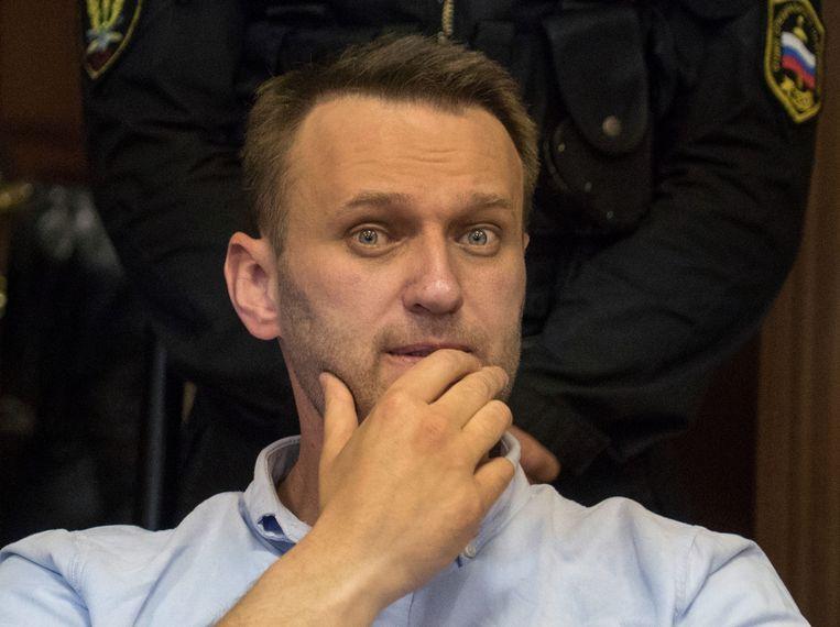 Alexej Navalny tijdens de rechtszaak waarbij hij werd veroordeeld voor 30 dagen cel voor deelname aan een demonstratie, Moskou 16 juni. Beeld AFP