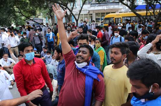 Demonstranten in Delhi demonstreren naar aanleiding van de groepsverkrachting en dood van een 19-jarige vrouw.