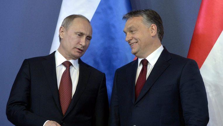 Russische president Vladimir Poetin en de Hongaarse premier Viktor Orbán. Beeld ANP
