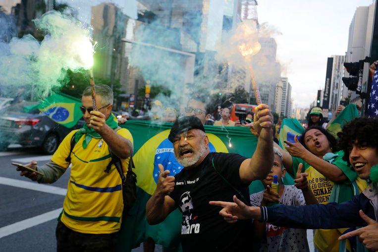 Aanhangers van Bolsonaro vieren feest. Beeld AP
