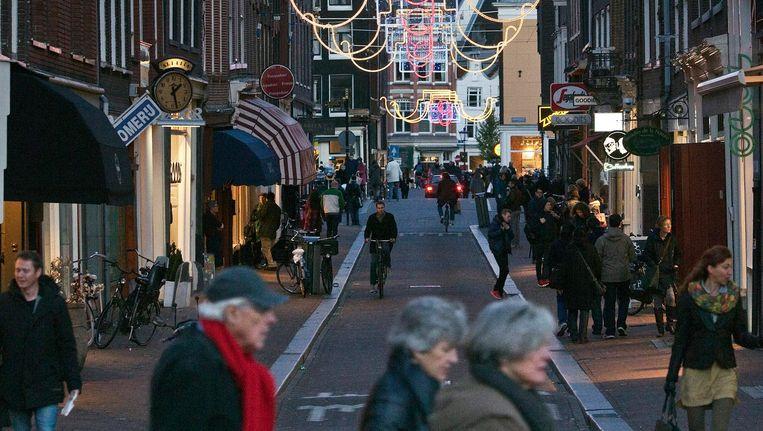 Voor bezoekers is het direct duidelijk dat ze behalve in de Huiden- of Runstraat vooral ook in de Negen Straatjes lopen Beeld Dingena Mol