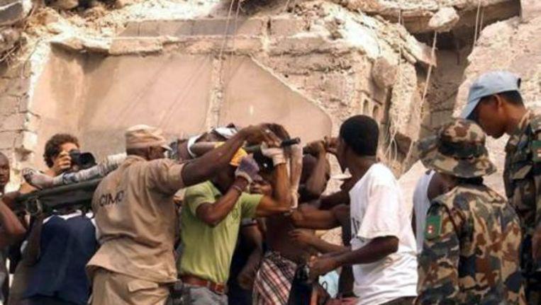 De president van Haïti vreest dat er mogelijk duizenden doden zijn gevallen door de zware aardbeving in zijn land. ANP Beeld
