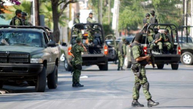 Het Mexicaanse leger zet een straat af voor een drugsoperatie in Monterrey, Mexico. ANP Beeld