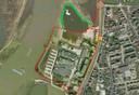 Het bestemmingsplan uit 2017. Met rode lijn gemarkeerd het plan van Abott. Een nieuwe rotonde met een inrit richting het parkeerterrein. De rechte rode lijn richting de IJssel zou de nieuwe dijk moeten zijn. De groene lijn is de huidige situatie, waarbij de dijk verlegd is.