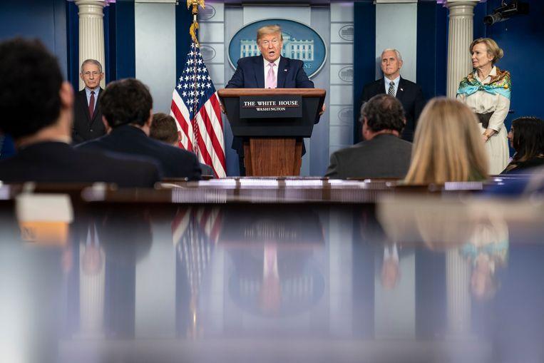 President Donald Trump tijdens persconferentie op 4 april 2020. Beeld Getty Images