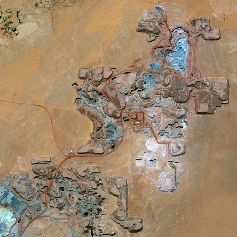 Satellietbeeld van de Arlit Uranium Mine in Niger, 2013. Beeld Getty