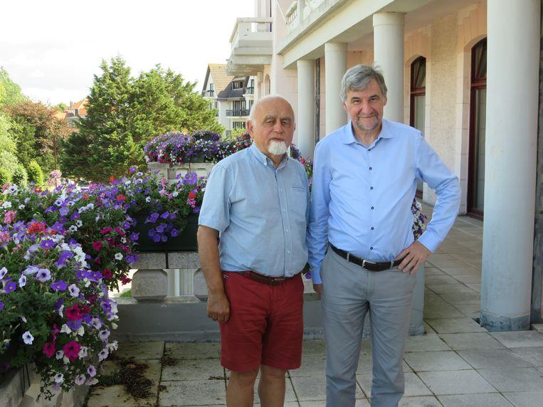 Een zomerse Jan Peumans en Wilfried Vandaele in De Haan.