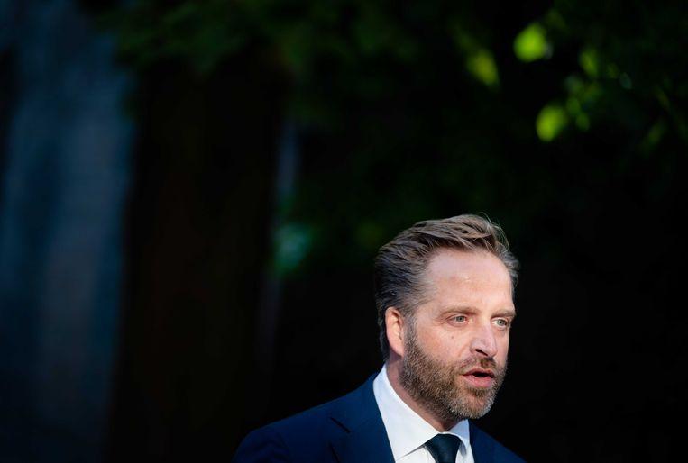 Demissionair minister Hugo de Jonge wil de vaccinatiegraad opkrikken, met name 'in grote steden, onder jongeren en in de Biblebelt'. Beeld ANP