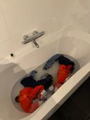 Schaatspakken in was/badkuip.
