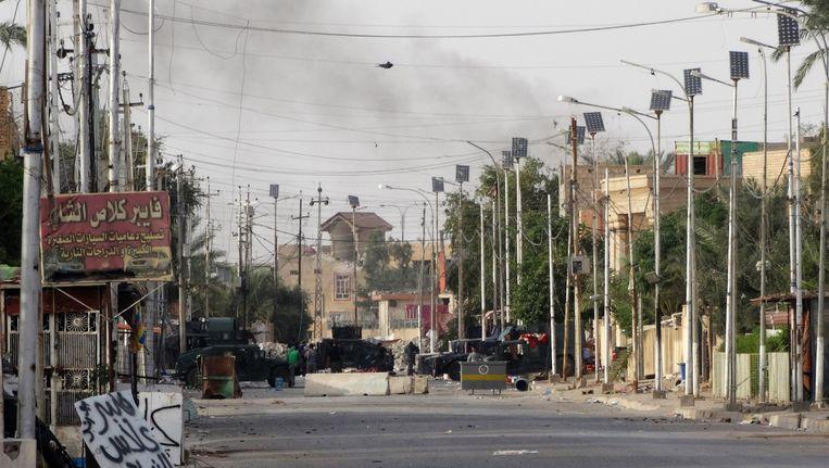 Iraakse troepen op de grond krijgen Amerikaanse luchtsteun in de Iraakse stad Ramadi Beeld ap