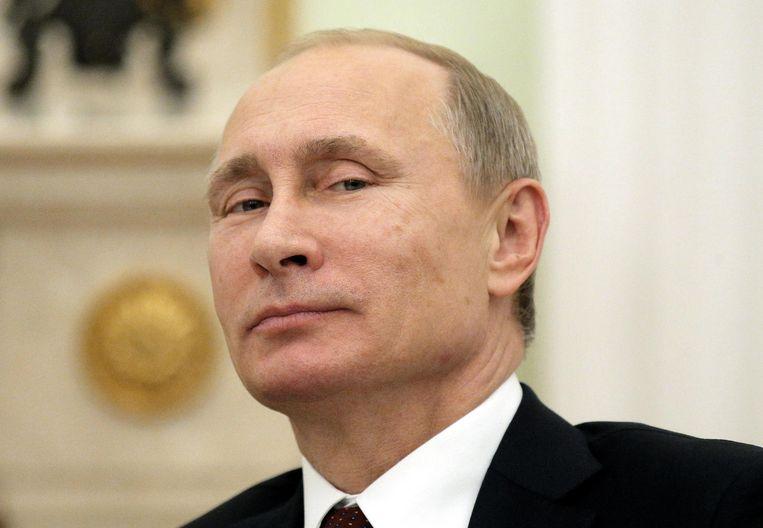 De Russische president Vladimir Poetin. Wie kritiek op hem uit, zet zijn leven op het spel. Beeld photo_news