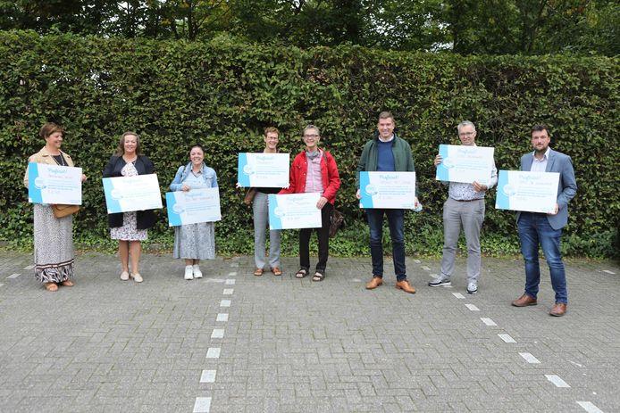 Acht Molse scholen werden beloond met een mooie cheque voor hun strijd tegen zwerfvuil.