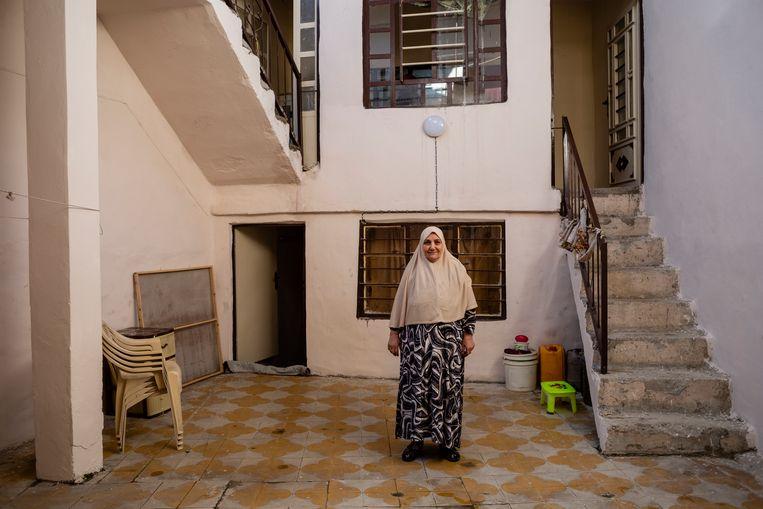 De herstelde huizen in West-Mosoel zijn fris beige gestuct.  Beeld Hawre Khalid