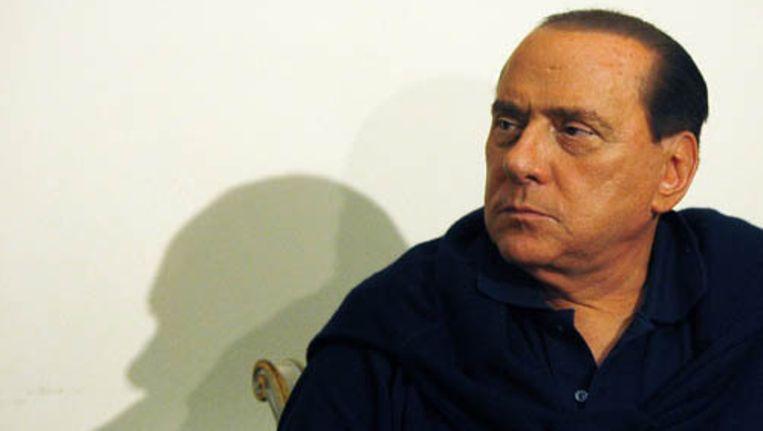 De Italiaanse premier Silvio Berlusconi heeft een milde vorm van de kinderziekte roodvonk. Foto EPA Beeld