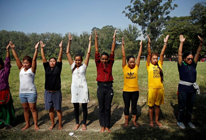 Women stretch their arms during their physical examination for the selection round to recruit temporary police personnel for the upcoming legislative elections, in Kathmandu, Nepal October 24, 2017. REUTERS/Navesh Chitrakar