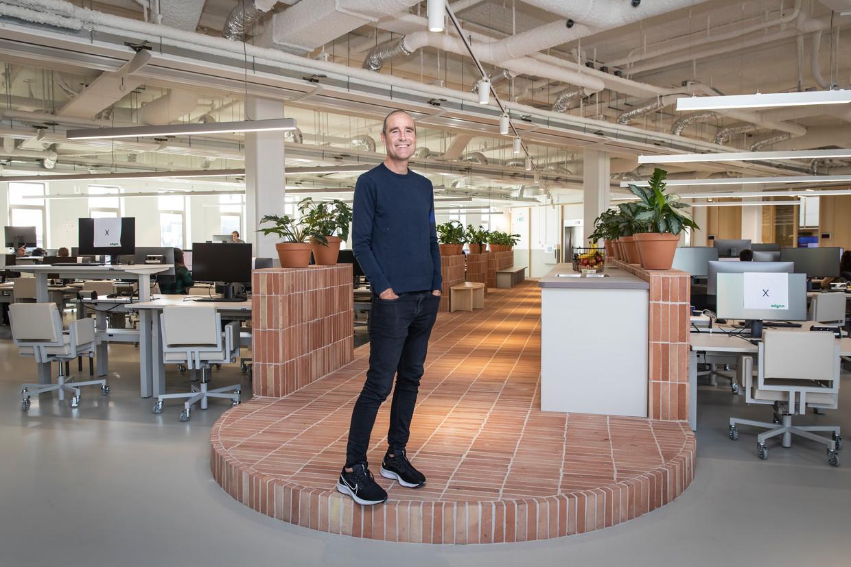 Adyenoprichter Pieter van der Does in het nieuwe onderkomen van de betaalgigant. Beeld Dingena Mol