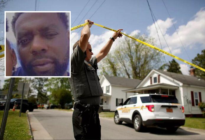 Een agent aan het plaats delict. Inzet: slachtoffer Andrew Brown junior.