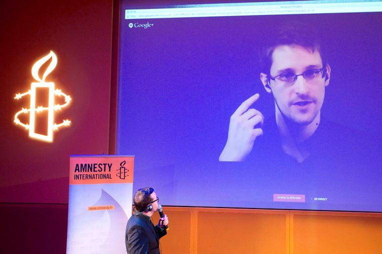 Edward Snowden tijdens een videoconferentie vanuit Moskou. Beeld Reuters