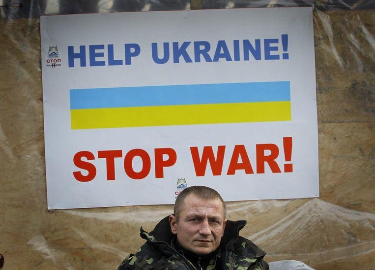 Een Oekraïense veteraan van de Maidan-beweging op het plein in Kiev. Beeld afp