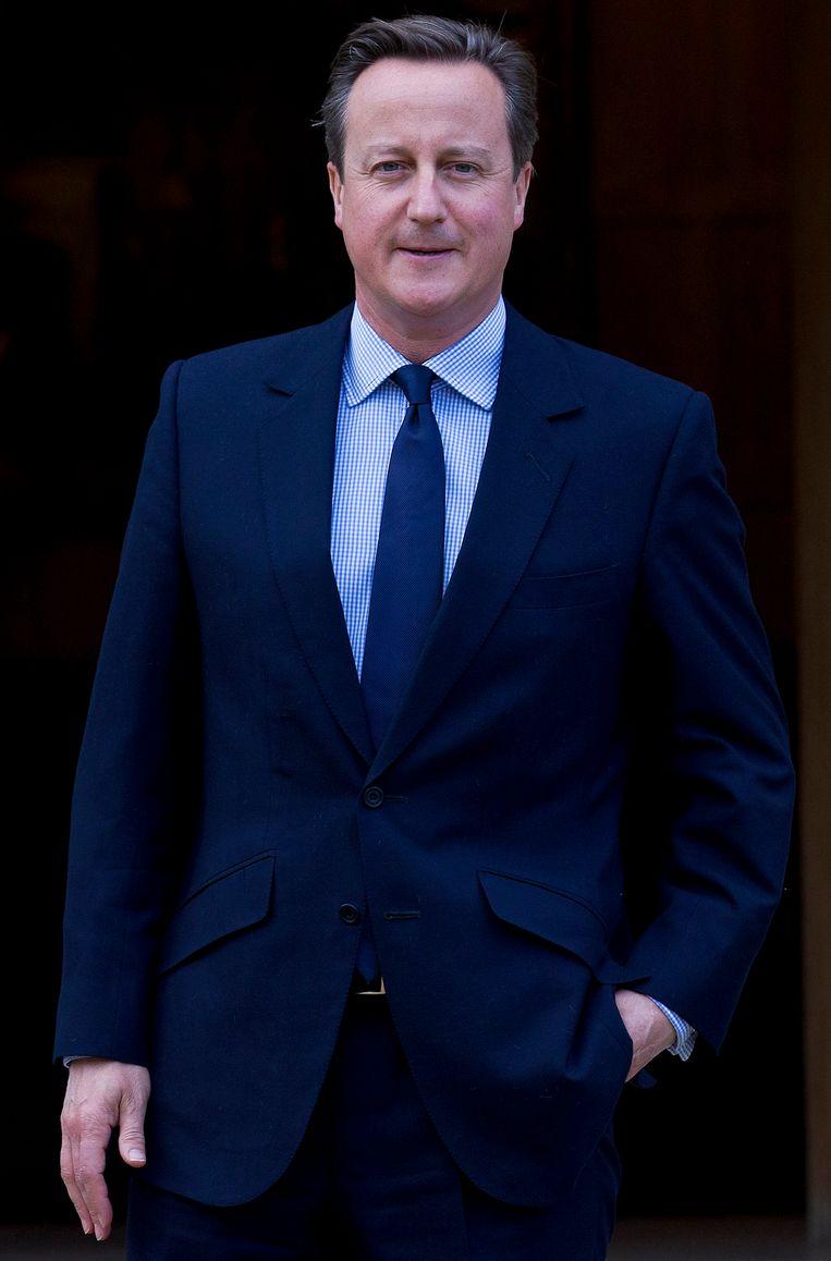 De Britse premier David Cameron, die in juli de vluchtelingen in Calais als