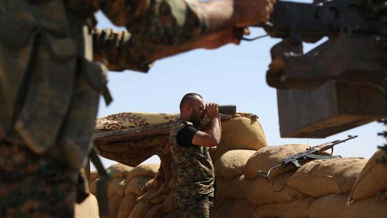 Koerdische strijders in de noordoostelijke Syrische stad Hasakeh. Beeld AFP