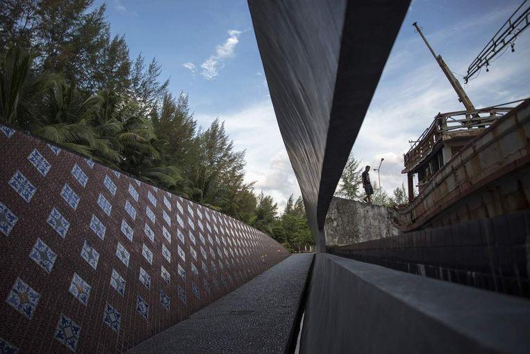 Het tsunamimonument in Ban Nam Khem, Thailand. Beeld REUTERS