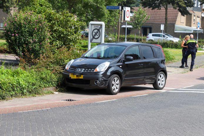 Deze auto kwam in botsing met een scootmobiel.