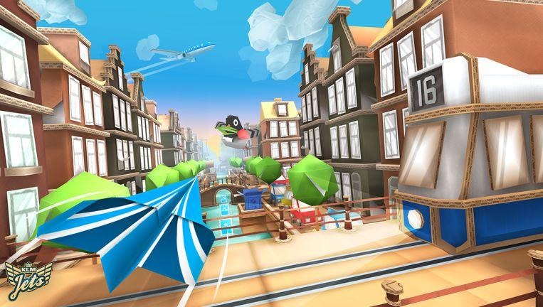 Beeld uit KLM-spel 'Jets' waarin met een papieren vliegtuigje langs de Amsterdamse grachten gevlogen moet worden om punten te verzamelen. Beeld KLM