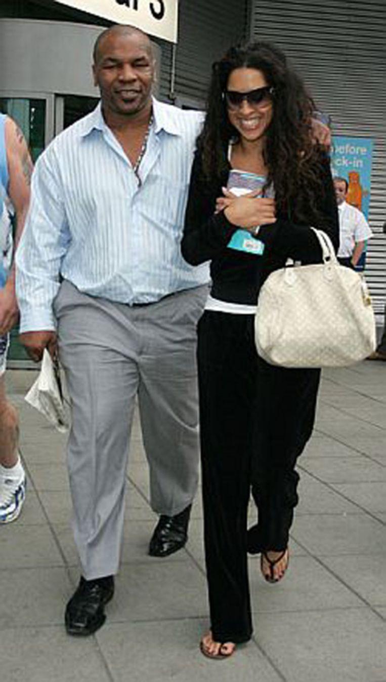 De Mike Tyson van 2009 samen met zijn vrouw Lakiha Spicer.
