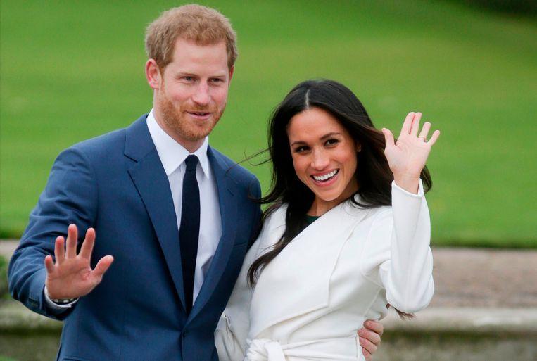 Prins Harry en zijn echtgenote Meghan Markle. Beeld AFP