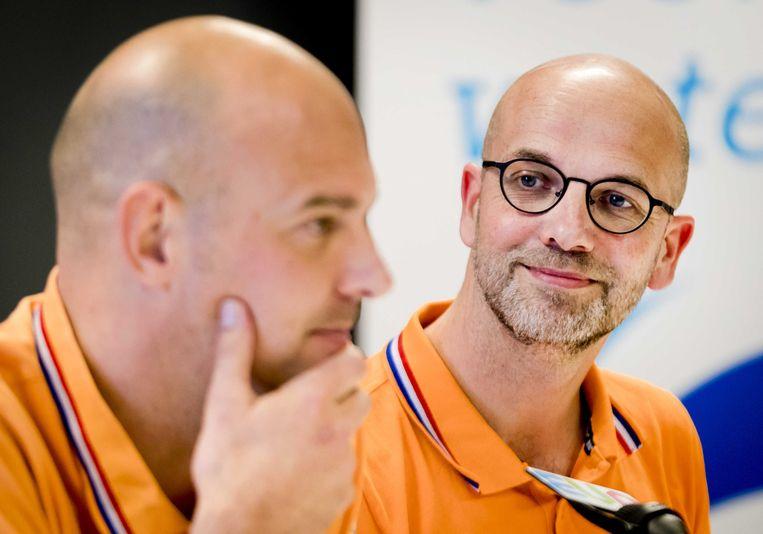 Marcel Wouda (l) en André Cats tijdens de persconferentie. Beeld ANP