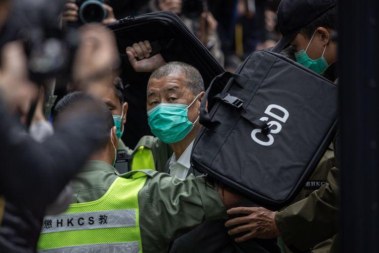 Februari 2021: Jimmy Lai wordt voor de rechter gebracht en tot een gevangenisstraf veroordeeld.  Beeld EPA