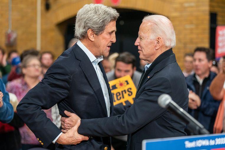 John Kerry (links) met Joe Biden. Beeld EPA