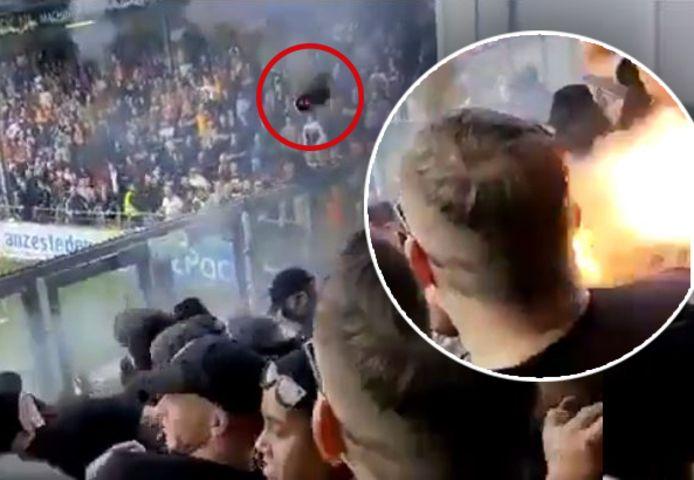 Op beelden op sociale media is te zien hoe een projectiel in het uitvak tussen de PEC-supporters terechtkomt.