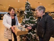 Rijen mensen in kerstwinkel voormalig C&A-pand in binnenstad