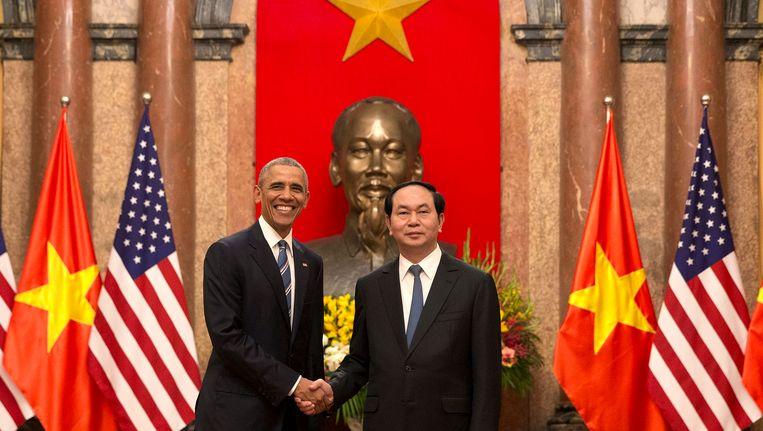 Barack Obama en Vietnamees president Tran Dai Quang in de Vietnamese hoofdstad Hanoi. Beeld AP