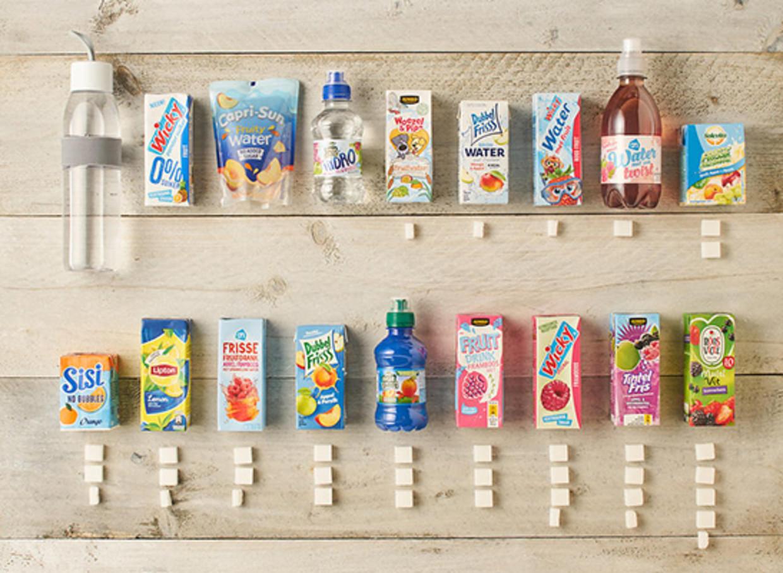 Suiker in kinderfrisdranken. Beeld Voedingscentrum