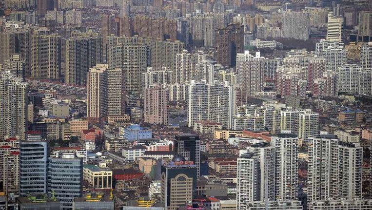 Pudong, het zakencentrum van Shanghai was tot 1990 landbouwgrond. Beeld AFP